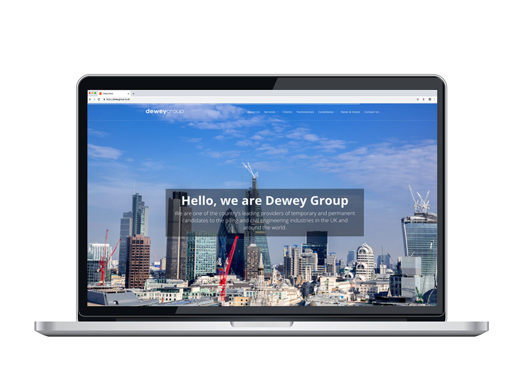 website design view on macbook London skyline with cranes home page for Dewey Group creative work website design and marketing