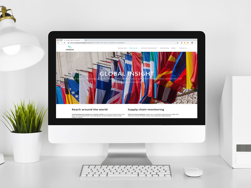 website design view on imac global flags global insight page for Octopus Intelligence creative work website design and marketing