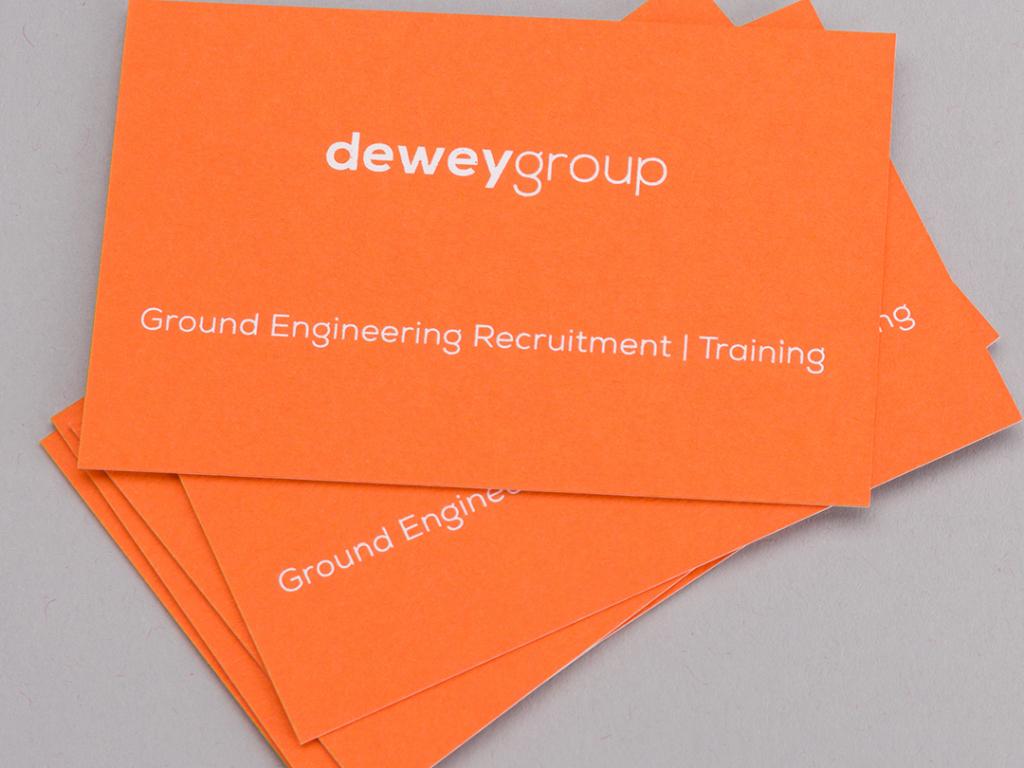 Dewey Group orange business cards creative work branding