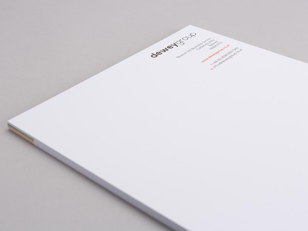 Dewey Group letterhead corporate stationery design creative work branding