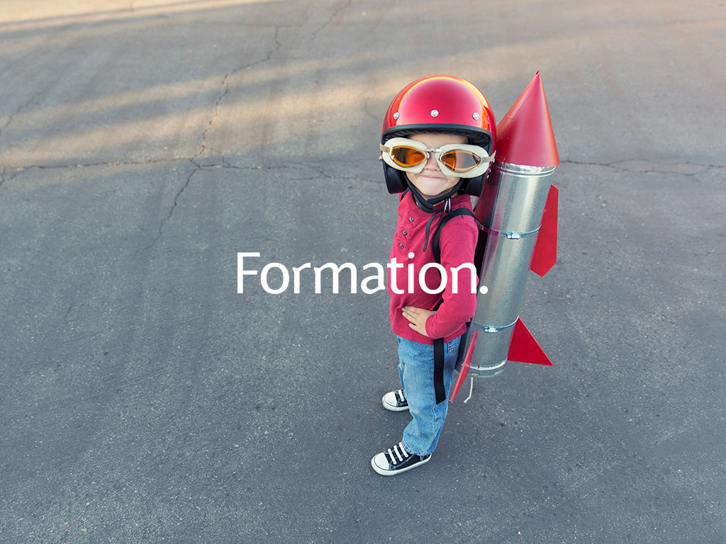 young girl with home made tin rocket on her back stood on concrete runway marketing concept created for Formation creativity