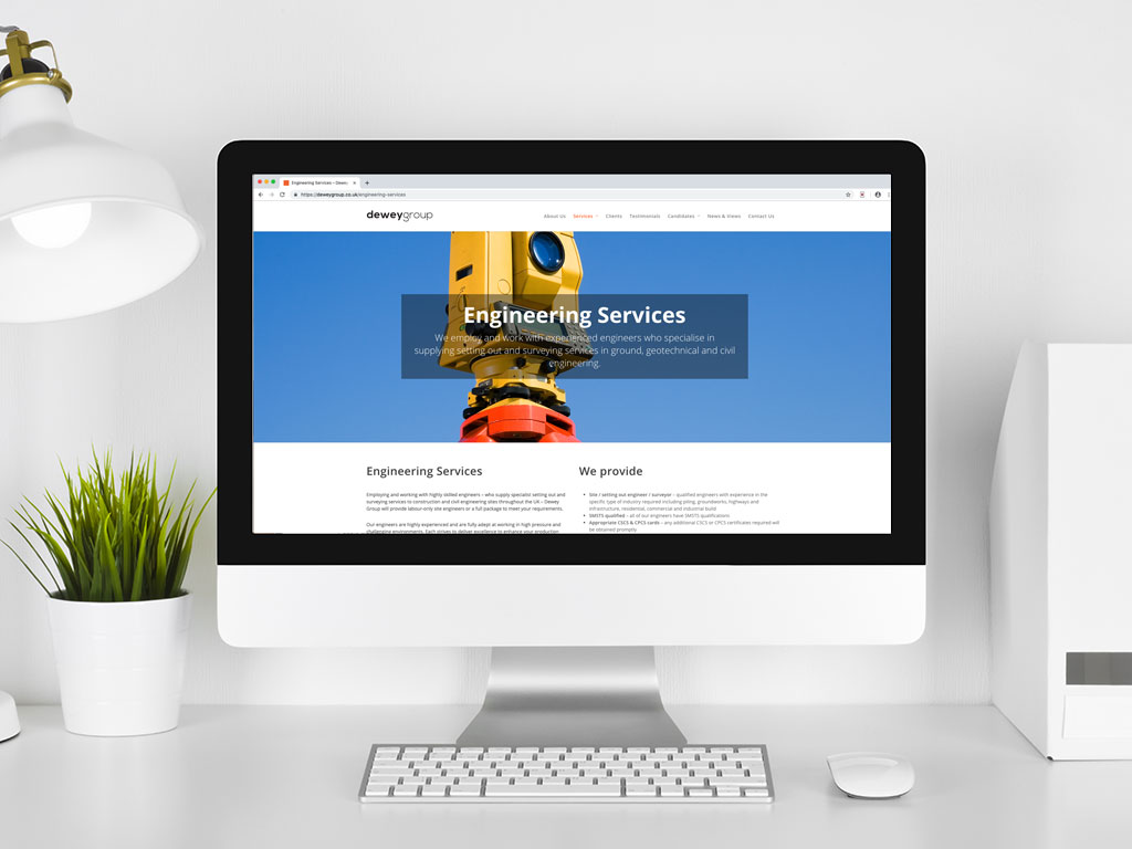 website design view on imac theodolite surveying and engineering services page for Dewey Group creative work website design and marketing