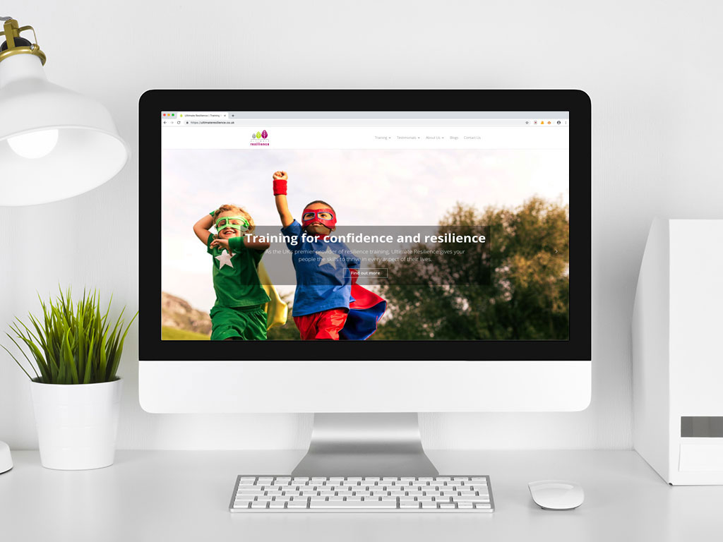 website design view on Imac super heros confidence training page for Ultimate Resilience creative work website design and marketing