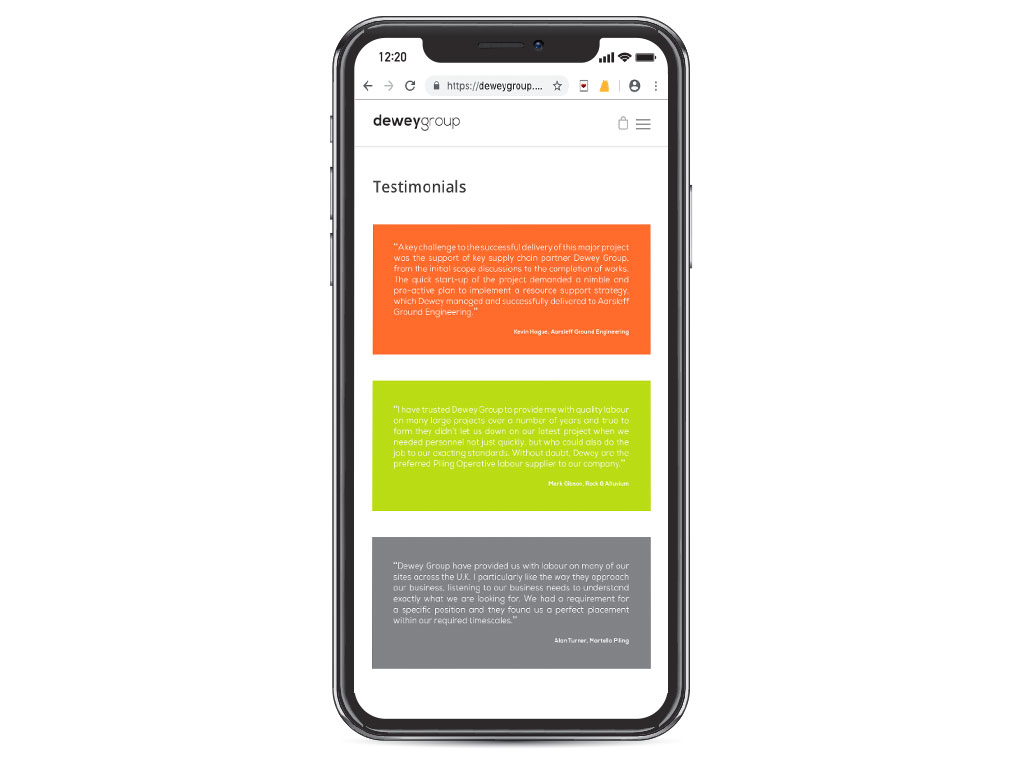 website design view on iphone X testimonial boxes page for Dewey Group creative work website design and marketing